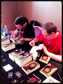 Craid and Rich getting down and dirty with their signatures.